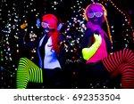2 sexy cyber glow raver women... | Shutterstock . vector #692353504
