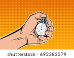 male hand holding stopwatch.... | Shutterstock . vector #692383279