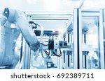 robotic machine tool in... | Shutterstock . vector #692389711