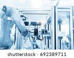 robotic machine tool in... | Shutterstock . vector #692389711