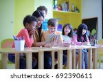 teacher kindergartner with... | Shutterstock . vector #692390611