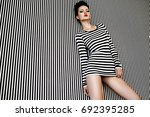 fashion woman in striped dress... | Shutterstock . vector #692395285