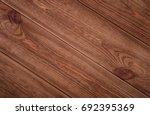 dark wood background. dark wood ... | Shutterstock . vector #692395369