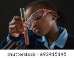 attentive schoolgirl doing a... | Shutterstock . vector #692415145