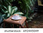 a cup of coffee on the table. | Shutterstock . vector #692445049