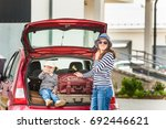 a young woman with a child puts ...   Shutterstock . vector #692446621