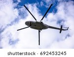a large helicopter is flying in ... | Shutterstock . vector #692453245