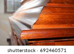wooden coffin for a dead person | Shutterstock . vector #692460571