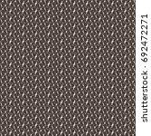 brown tweed fabric pattern....   Shutterstock .eps vector #692472271