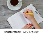 woman writing essay in notepad... | Shutterstock . vector #692475859