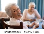 smiling senior woman playing... | Shutterstock . vector #692477101