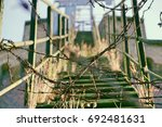 Old Rusty Staircase With Barbe...