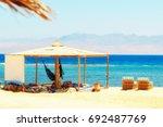 sunbeds  hammock   simple tent... | Shutterstock . vector #692487769