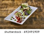 beautiful and tasty food on a... | Shutterstock . vector #692491909