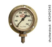Small photo of Grungy old brass air pressure gauge isolated on white background