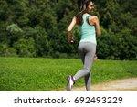 athletic happy brunette woman... | Shutterstock . vector #692493229