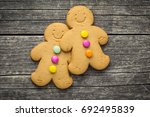 two sweet gingerbread men on... | Shutterstock . vector #692495839