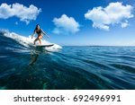 Young beautiful girl surf on...