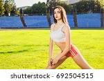 young beautiful fitness girl... | Shutterstock . vector #692504515