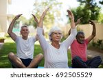 senior people exercising with... | Shutterstock . vector #692505529