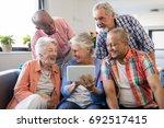 senior woman showing digital... | Shutterstock . vector #692517415