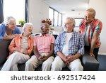 smiling senior friends... | Shutterstock . vector #692517424