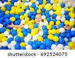 happy little girl having fun in ... | Shutterstock . vector #692524075