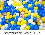 happy little girl having fun in ... | Shutterstock . vector #692524135