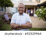 portrait of smiling senior man... | Shutterstock . vector #692529964