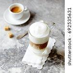 glass of latte macchiato and a...   Shutterstock . vector #692535631