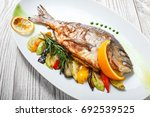 grilled dorado fish with baked... | Shutterstock . vector #692539525