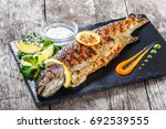 grilled sea fish with lemon on... | Shutterstock . vector #692539555