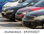 the cars built in a row stand... | Shutterstock . vector #692542027