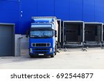 blue truck at loading docks.... | Shutterstock . vector #692544877