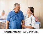 smiling senior man looking at... | Shutterstock . vector #692545081