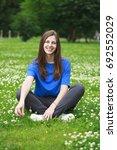 happy young brunette woman in...   Shutterstock . vector #692552029