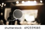 microphone on abstract blurred... | Shutterstock . vector #692559085