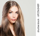 beautiful woman with long brown ... | Shutterstock . vector #692563489