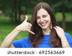 beautiful brunette woman making ... | Shutterstock . vector #692563669