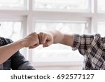 team business partners giving... | Shutterstock . vector #692577127