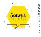 seasons greetings lettering in... | Shutterstock .eps vector #692583049