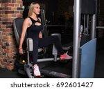fitness woman doing breeding... | Shutterstock . vector #692601427