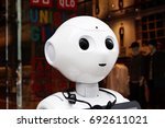 Small photo of TOKYO, JAPAN - August 4th, 2017: The head of a Softbank Pepper robot. The robot is making multi-lingual announcement outside a Uniqlo store in Tokyo.