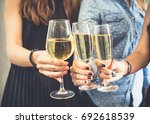 group of women celebrating in a ... | Shutterstock . vector #692618539