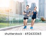 sport couple running in city | Shutterstock . vector #692633365