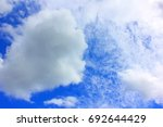 cloud in the blue sky. | Shutterstock . vector #692644429