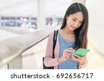 woman looking at mobile phone... | Shutterstock . vector #692656717