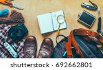 hiking accessories on wooden... | Shutterstock . vector #692662801