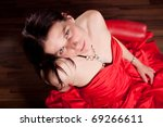 woman in a red evening gown seen from top - stock photo