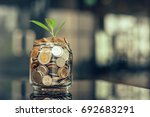 plant growing out of coins with ... | Shutterstock . vector #692683291
